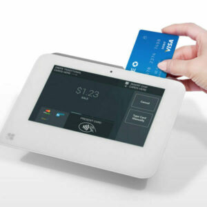 hand putting card into payment processing terminal